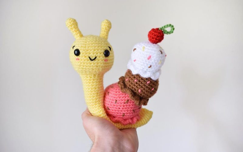 chrocheted amigurumi snail with ice cream shell